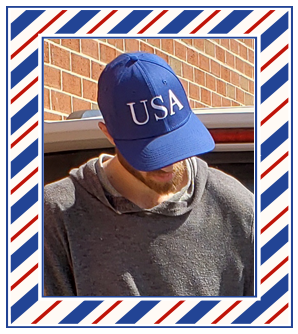 Guy wearing and Official Blue USA Hat